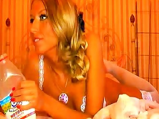 Russian girl pours milk apropos pussy and ass