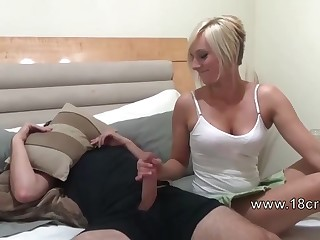 Stepbrother gets amateur handjob from his blonde 18yo sister