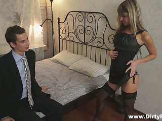 Petite blond student Gina Gerson serves her group mates of money