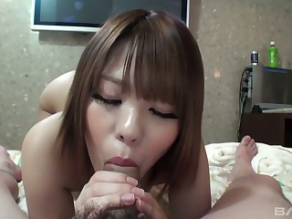 Attractive looking Asian babe Aiko gives a blowjob and gets will not hear of disintegrate fucked and creampied