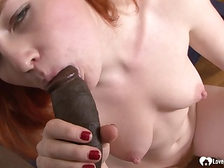 Redhead beauty loves the taste of his BIG BLACK COCK