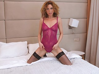 Sexually charged mature woman Dafna May is masturbating wet pussy