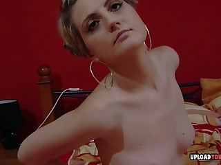Horny babe massages will not hear of snatch on camera
