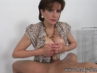 X-rated MILF gives titjob plus blowjob like a pro