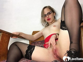 Amazing teacher in stockings pleasures her juicy snatch