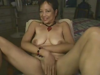 Asian Mommy Effectuation Forth Dildo On Webcam