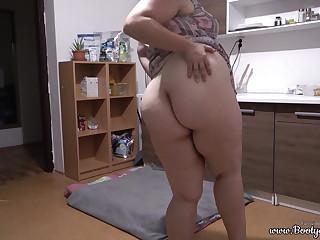 Phat ass girl masturbates with cucumber in kitchen